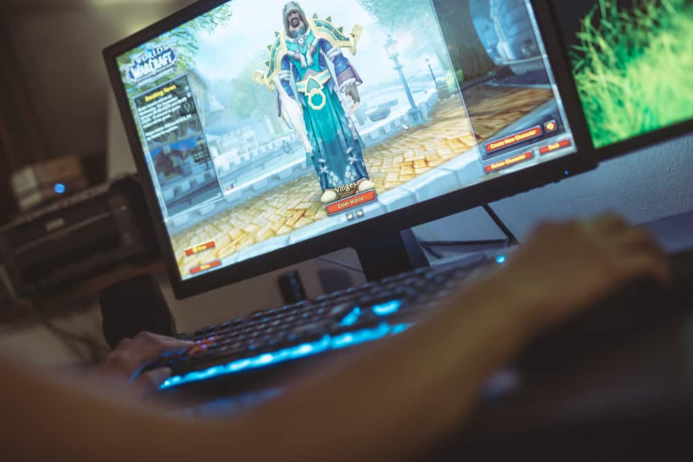 WROCLAW, POLAND - SEPTEMBER 04th, 2018: Woman playing World of Warcraft: Battle of Azeroth game. WoW is a massively multiplayer online role-playing game (MMORPG) released in 2004 by Blizzard Entertainment.